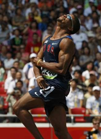 图文-刘翔出战110米栏预赛 特拉梅尔很痛苦