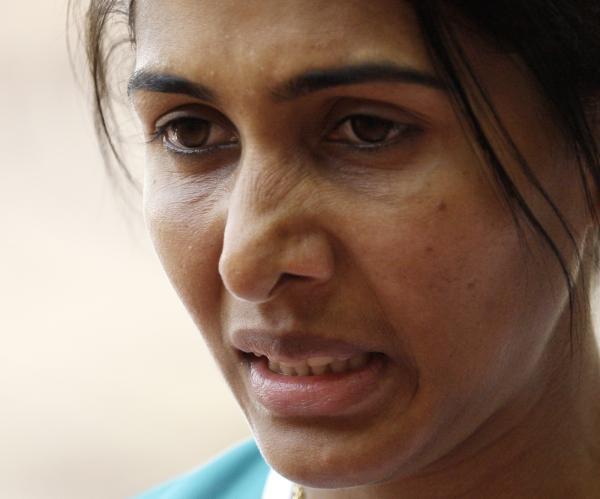 图文-奥运女子三级跳远决赛展开 沮丧的神情