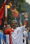 图文-奥运圣火在北京首日传递 巴基斯坦人马利克