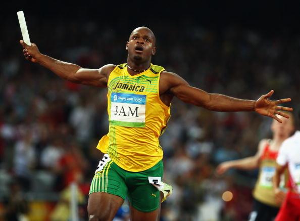 图文-牙买加刷新4x100纪录 鲍威尔率先冲线