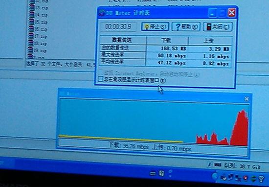 在广州移动办公大楼里用笔记本电脑插TD-LTE上网卡,测得的最高下载速率为60Mbps