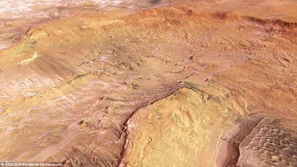 """""""火星快车""""拍摄到的这颗红色行星上的阿尔及尔和霍克陨石坑,在图片右上角能够清楚看到冻结成冰的二氧化碳"""