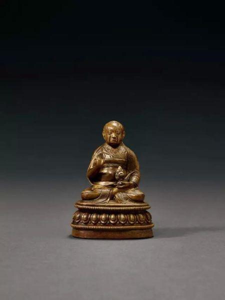Lot.660 明早期 铜嵌银萨迦派祖师坐像 9.8cm. High