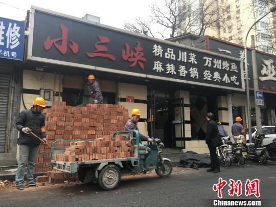 """北京核心区严整开墙打洞 将恢复""""灰墙灰瓦""""胡同特色"""