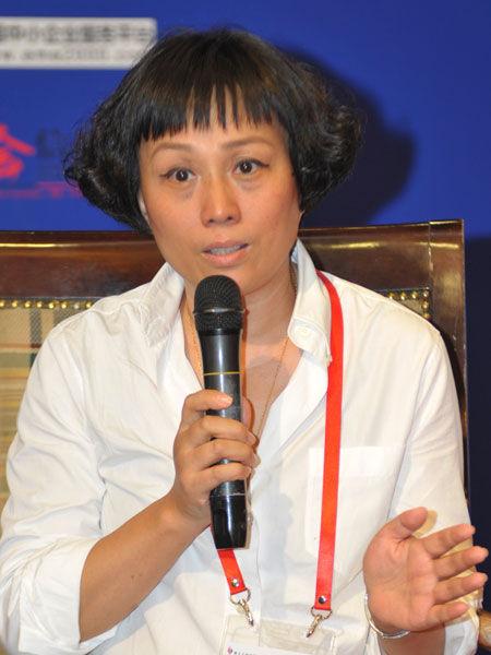 """""""2013中国金融论坛""""于2013年5月21日-23日在北京召开。上图为法国维迪阿投资银行董事局主席吴亭亭。(图片来源:新浪财经)"""