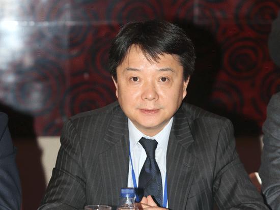 """由《英才》杂志、新浪网、北京青年报共同主办""""2014(第十四届)中国年度管理大会""""于11月28日在北京举办。上图为美国高通公司大中华区总裁王翔。(图片来源:新浪财经)"""