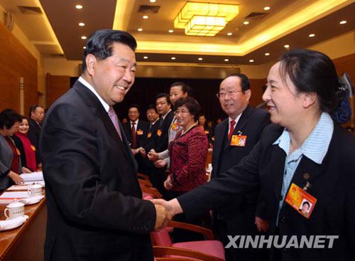 贾庆林参加北京代表团审议强调统筹城乡发展