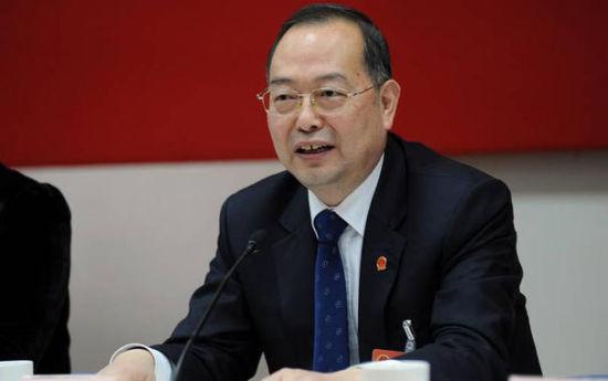 图片说明:2013年杨振武参加上海市政协会议。