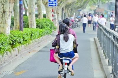 自行车带人也会被罚款?