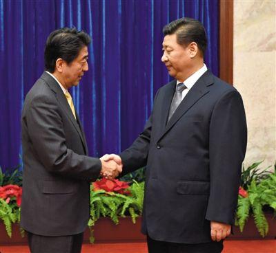 昨日,国家主席习近平在北京人民大会堂应约会见日本首相安倍晋三。新华社记者 马占成 摄