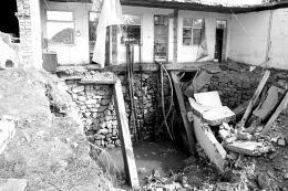 房屋因被建在水井上深夜坍塌致夫妻坠井身亡
