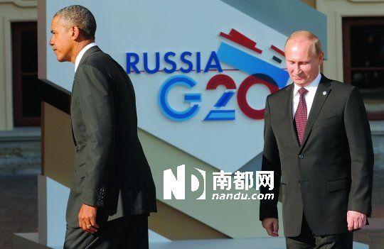 5日,俄罗斯圣彼得堡,奥巴马(左)抵达康斯坦丁宫参加G20峰会,与普京握手后转身离开。