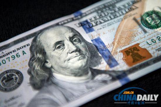 新版100元美钞_新版百元美钞;  防伪功能突出[;     新版美钞采用了