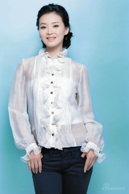 组图:王艳用福娃当爱子教材 打造奥运宝宝图片