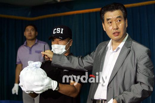 图文:警方公布崔真实案进展-嫌犯家中发现的崔真实骨灰