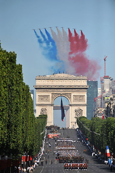 French National Day military parade ground parade team through the Arc de Triomphe
