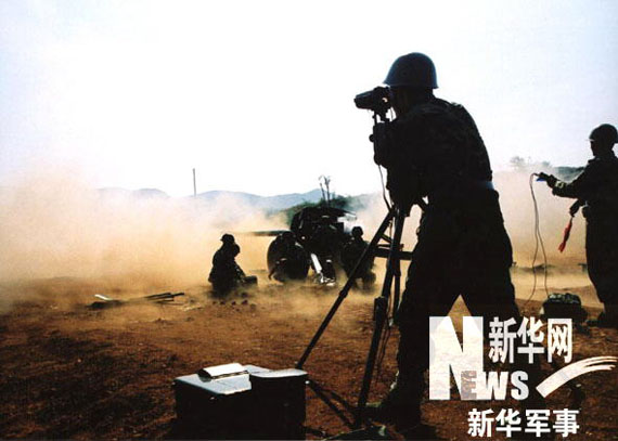 anti-tank guns firing. Li Jin photo