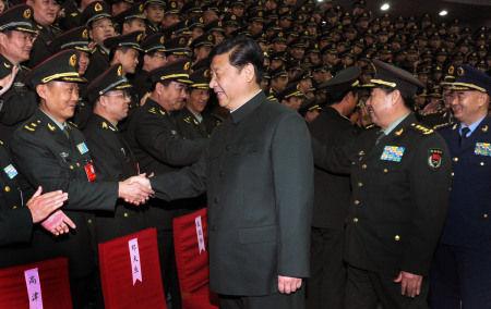 12月5日,中共中央总书记、中央军委主席习近平在北京会见第二炮兵第八次党代表大会代表。新华社记者李刚摄