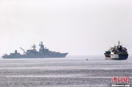 中俄联合解救被劫持船舶演练。中新社发 盛佳鹏 摄