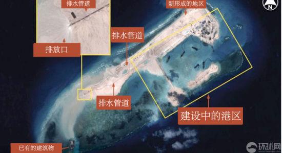 """资料图:2014年11月23日报道,军事杂志《简氏防务周刊》11月21日刊登了中国在南沙群岛的永暑礁建设的""""新人工岛""""照片。该人工岛疑似为机场跑道。"""