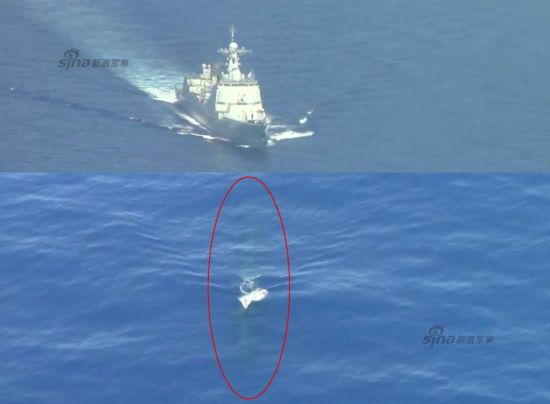 """近日,美国vimeo网站上传了一段2014年美军VP5巡逻机中队在美日联合军演中的视频集锦,其中出现了美军P-8A巡逻机近距离拍摄中国海军052C导弹驱逐舰的画面。   视频出现的一段美军P-8A""""海神""""反潜巡逻机的内容特别引人注意,视频中不但有P-8A反潜巡逻机飞行巡逻的画面,还出现了P-8A拍摄的中国052C神盾舰和一段不明国籍潜艇潜望镜深度航行的画面。图为该视频中出现的中国海军052C导弹驱逐舰画面。"""