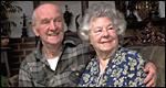 Elderly couple sitting together smiling