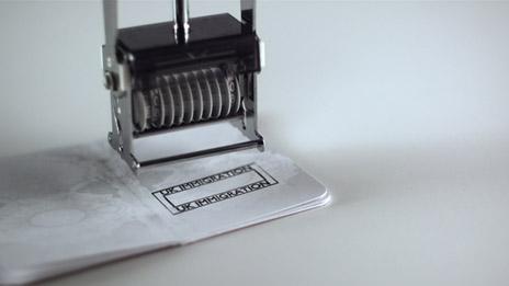 A passport being stamped