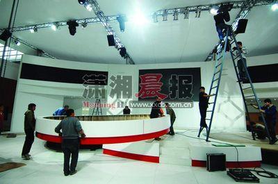 11月28日,长沙车展会场布展进入尾声。本组图片/记者张轶 黎金龙