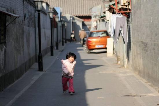 新浪旅游配图:半米阳光北京胡同 来源:曼德拉草的新浪博客