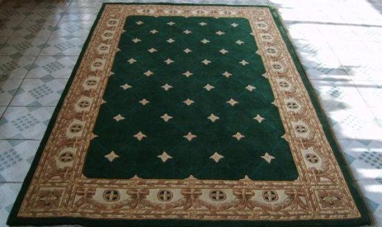 版纳地毯   是我国羊毛手工编织地毯中具有独特