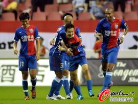 冯仁亮致胜球泰达两轰门柱上海1比0主场逢津不败