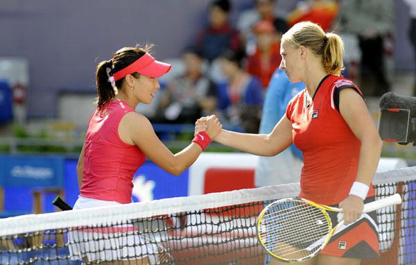 Svetlana Kuznetsova of Russia returns a shot to Zheng Jie of China