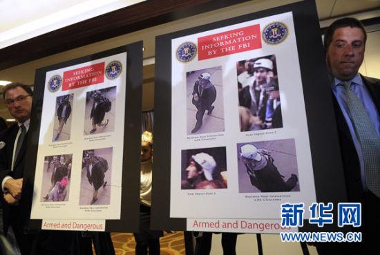 4月18日,在美国波士顿举行的新闻发布会上,警方公布波士顿爆炸案两名嫌犯图像。新华社记者张军摄